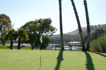 Shadows of palm trees fall on the course at Avila Beach Golf Resort